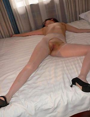 Skanky Chinese slut posing in her pantyhose